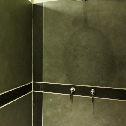 Grey and black patterned shower wall tiles