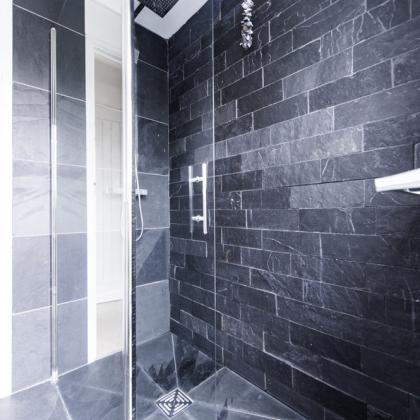 Beautiful slate brick pattern wall tiles in a bespoke shower room.