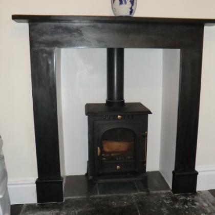 Woodburner with slate hearth and wood surround