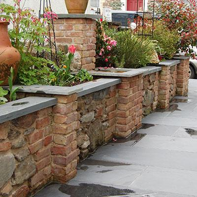 Garden flower beds with a slate copping top