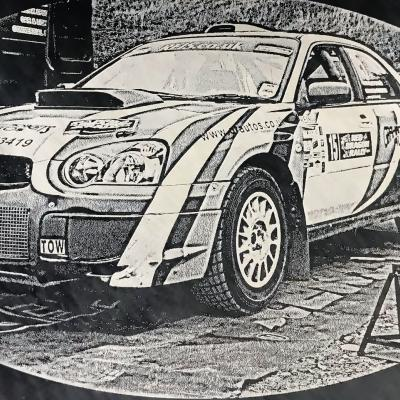 racing car etched onto slate