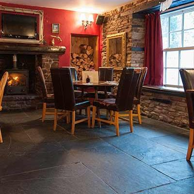 Traditional flagstones in a restaurant providing a natural flooring with an authentic feel.