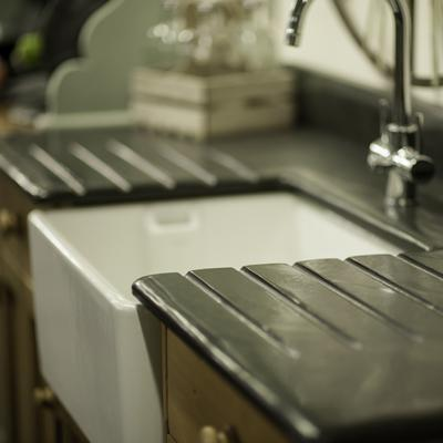 A Belfast sink draining board in slate custom cut by Ardosia.