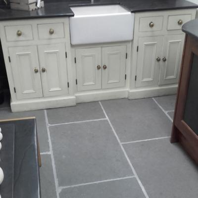 riven endge floor tiles in limestone