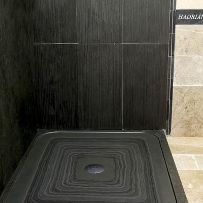 Corner shower tray in slate and showers with slate wall caldding