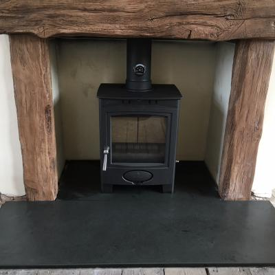 black slate fire hearth with a woodburner from Ardosia