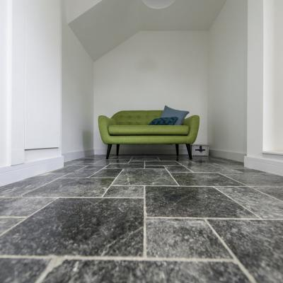 Polished floor tiles in slate for a lounge or dining area in a modern home