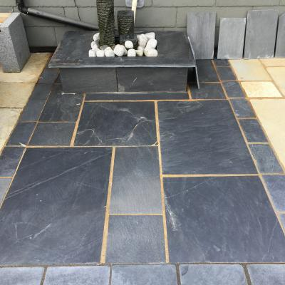 Geometric slate paving with a slate water feature