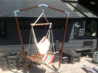 rocking chair in the sun with garden patio in slate