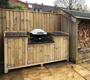 Custom wooden frame with slate barbecue worktop