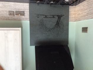 Engraved tree and bench on oven splashback