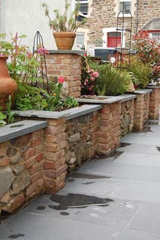 Slate coping Stones on Raised Flower Beds