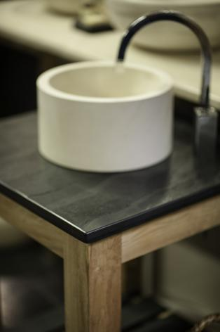 Contemporary stand alone sink and surround in slate