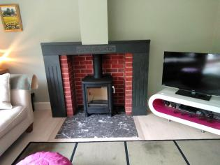 Slate mantle and surround with a marble hearth