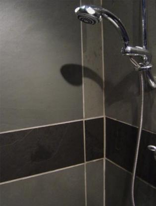 Slate shower panels in black and grey tiles