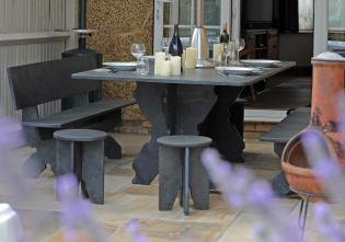 Slate stools and benches with table in solid slate