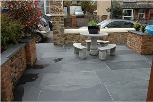 Black slate flagstones unsealed on a patio