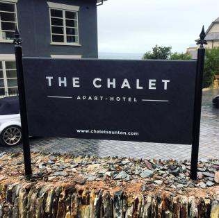 Contemporary hotel slate sign