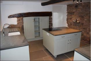 Blue grey worktop made from slate in a cottage kitchen