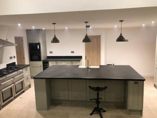 Breakfast bar in a modern kitchen with a slate work surface