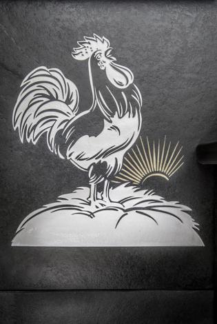 ockerel engraved onto slate