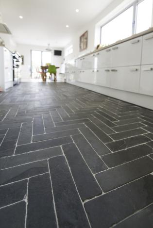 patterned slate cooble styled flooring in a contemporary kitchen