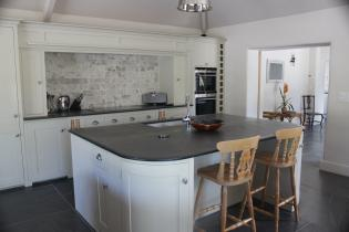 rounded kitchen worktop with smoothed edges and a breakfast island
