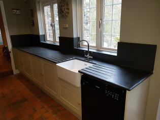 Sunken Belfast sink in a gally kitchen with slate worktop