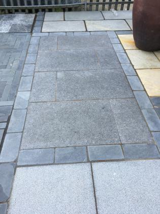 Polished slate paving in dark grey for a patio