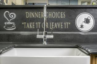 Recessed sink with slate surround and splash board with bespoke engraved sign