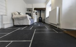 Contemporary living room with flagstones in slate
