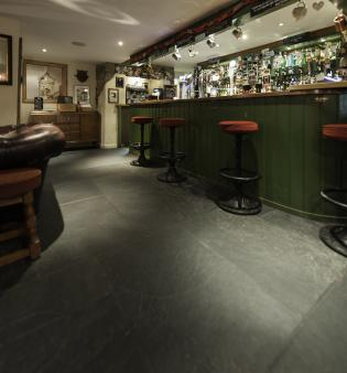 traditional English pub flagstone floors and bar stools