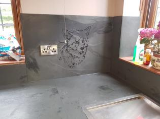 Engraved slate wisgn with a fox in a kitchen