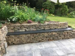 patio slabs in slate with bench and stone