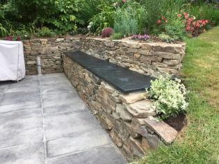 garden slate bench set on stone