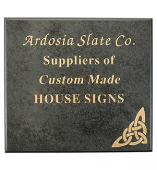 Gold letter slate sign for a house