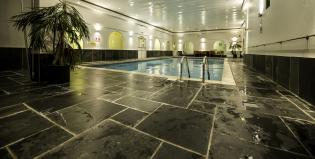 swimming pool with slate protective skirting around the edges