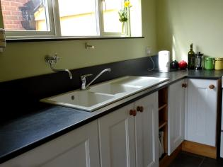 sink surround in slate with over hanging tap