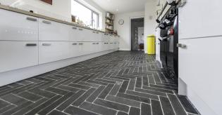 Bespoke kitchen with natural slate floor tiles