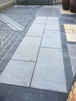 Polished patio with light grey paving slabs