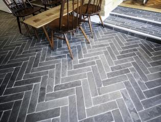 Restaurant floor by table with cobbles in natural slate.