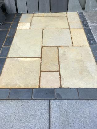 Nautral stone paving slabs in a cream colour in a patio pack