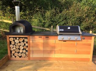 Full outdoor kitchen with slate bbq and oven from Ardosia