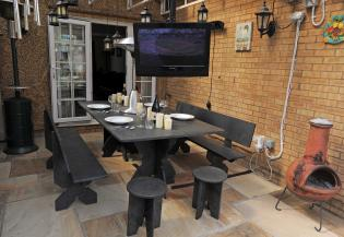 Patio area with slate table and chairs