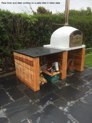 pizza oven with slate surround and garden flagstones