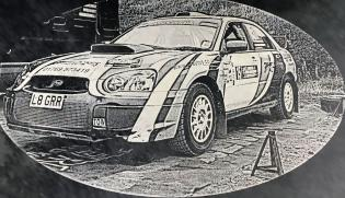 Slate etched with an image of a rally car