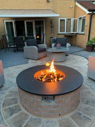 Slate fire pit in contemporary garden