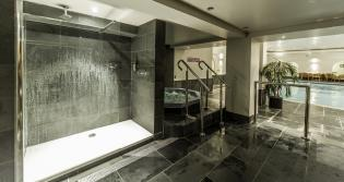 Commercial shower with slate shower tile surrounds for a swimming pool