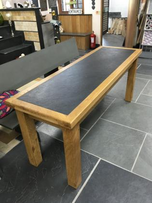 Custom made wooden table with a slate inset worktop