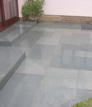 polished exterior floor tiles for slate paved garden area